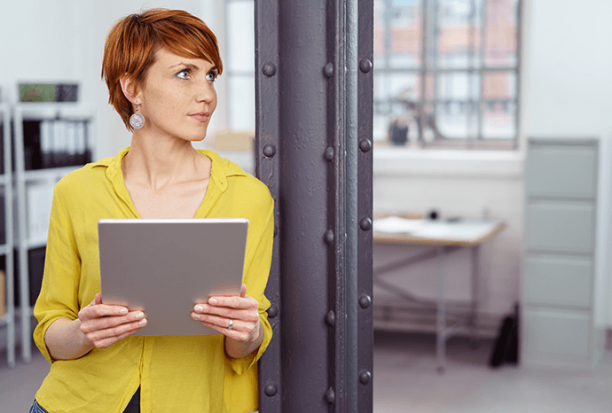 Woman in an office holding a tablet